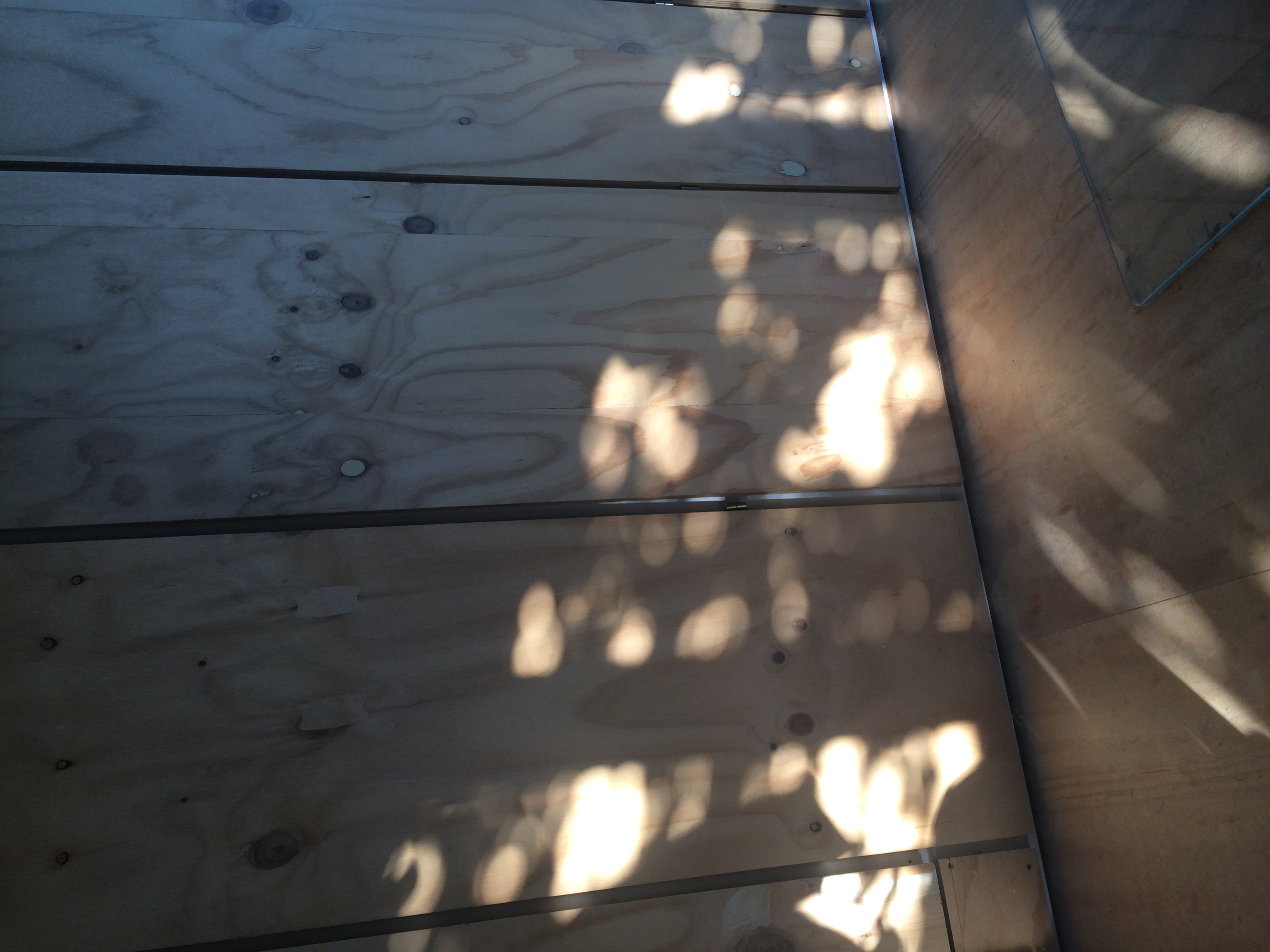 The play of shadow against a wooden wall is sometimes all you need |  Garden architecture by Andrew van Egmond